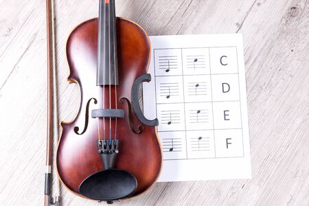 Classical violin with music sheet book. Classical musical instrument