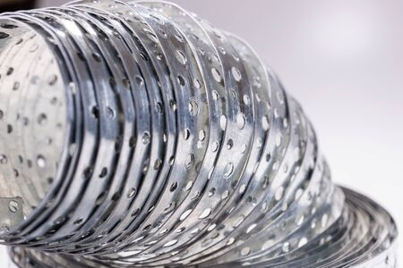 Closeup metal galvanized rolled steel band with holes