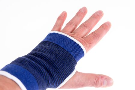 Left hand with a blue bandage. Carpal tunnel syndrome brace Stock Photo