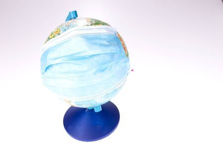 World globe with medical face mask. Coronavirus, COVID-19 concept. Planet Earth in pandemic. Travel restrictions Stock Photo