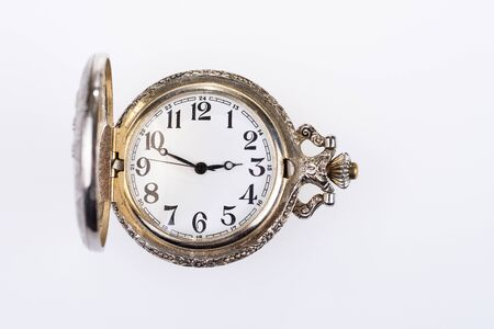 Antique analog pocket watch with hands and numbers. Vintage pocket watch