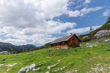 Wooden hut on the austrian mountains in the region Salzkammergut. Austria