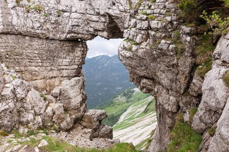 View of the mountains from rock window in Loser peak. Dead Mountains in Austrian Alps