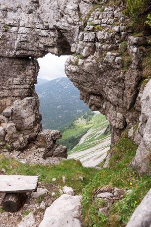 View of the mountains from rock window in Loser peak. Dead Mountains in Austrian Alps 免版税图像 - 150241154