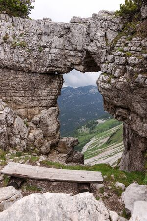 View of the mountains from rock window in Loser peak. Dead Mountains in Austrian Alps 免版税图像 - 150241237
