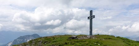 View of the big cross at the top of Loser peak in Dead Mountains (Totes Gebirge) group of mountains in Austrian Alps