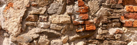 Wall panorama background. Old broken red brick wall with cement mortar