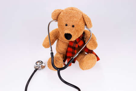 Doctor teddy bear with medical stethoscope isolated
