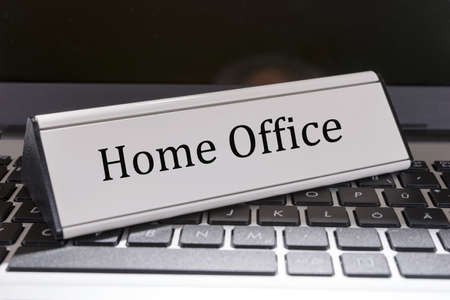 Laptop keyboard with sign Home office lettering