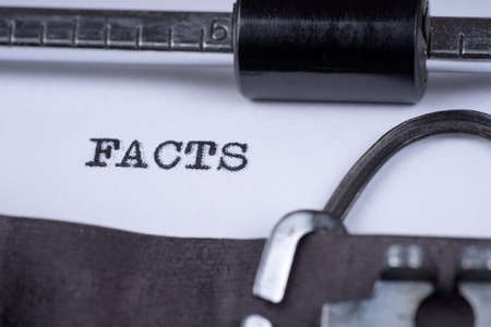 The word Facts written on an old typewriter