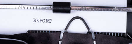 Word Report written with a vintage typewriter. Panoramic image