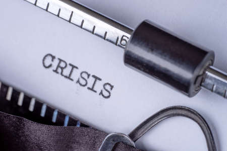 Crisis typed on white paper with retro typewriter Stok Fotoğraf
