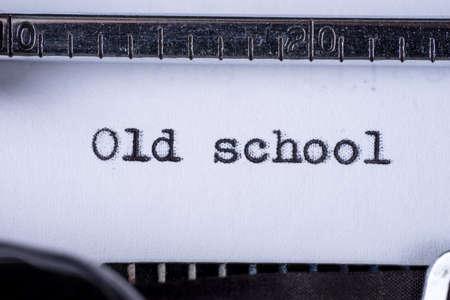 Old school written with a vintage typewriter