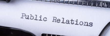 Public Relations printed on an old black typewriter. Panoramic image