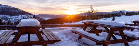 Beautiful winter sunset in the mountains. Wonderful view from the terrace