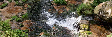 Wonderful panoramic landscape with moss and stones in the mountain river. Natural panoramic background
