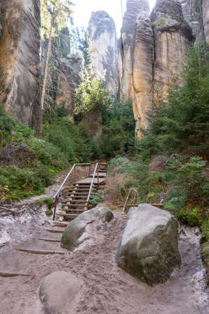 Footpath with wooden ladder in the majestic sandstone rock walls. Adrspach rock city, Czech Republic, Europe