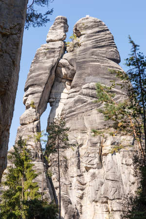 Mighty tall sandstone rock formation with name Lovers in nature tourism destination - Adrspach rock city, Czech Republic, Europe