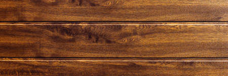 New plastic fence background in dark brown wood look. Panoramic image