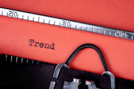Trend. Text written on a red paper made by old typewriter