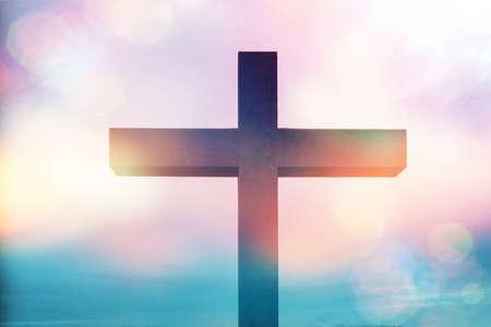 Christian cross with colorful bokeh lights
