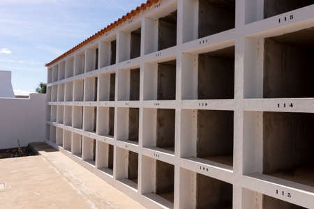 Empty grave sites with numbers in the cemetery. Canary Islands Stock Photo
