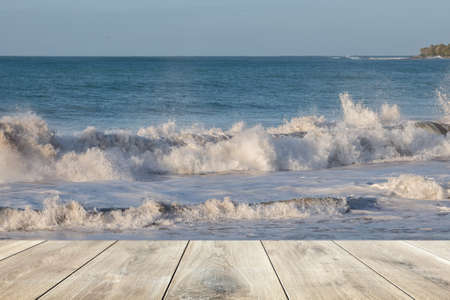 Wooden plank and ocean wave in the background