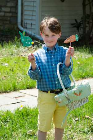 Young Boy Outside Dressed Up for Easter holding Basket