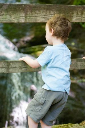 Boy looking at Crabtree Falls along the Blue Ridge Parkway near Asheville North Carolina