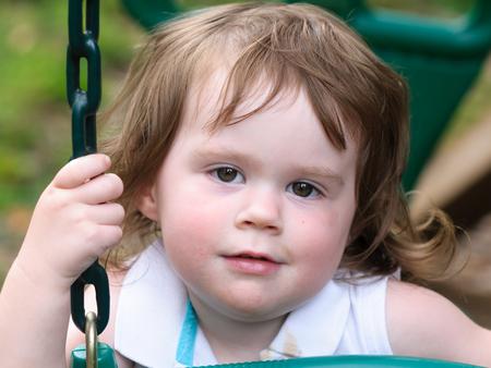 Young girl having fun on a swing
