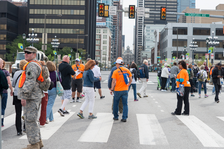 vicar: PHILADELPHIA, PA - SEPTEMBER 26: Crowds of people arrive on the Benjamin Franklin Parkway in Center City Philadelphia to see Pope Francis at the World Meeting of Families on September 26, 2015 Editorial