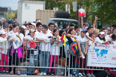 PHILADELPHIA, PA - SEPTEMBER 26: Crowds of people arrive on the Benjamin Franklin Parkway in Center City Philadelphia to see Pope Francis at the World Meeting of Families on September 26, 2015 Editorial
