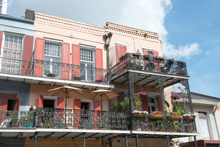 NEW ORLEANS, LA - APRIL 13: Street in the French Quarter of New Orleans, Louisiana showing historic buldings with unique architecture on April 13, 2014 Editorial
