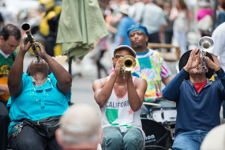 NEW ORLEANS - APRIL 13: In New Orleans, a jazz band plays jazz melodies in the street for donations from the tourists and locals passing by on April 13, 2014 Editöryel