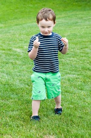 Portrait of a cute adorable little boy child running on grass