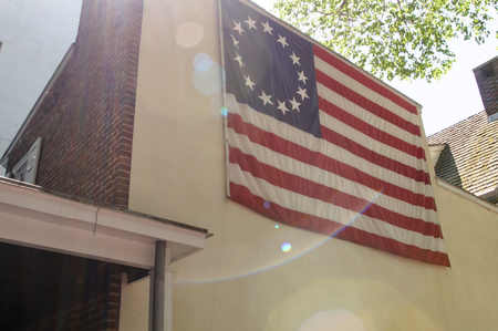 thirteen: PHILADELPHIA, PA - MAY 14: American thirteen point historic flag often named the Betsy Ross flag, in front of the Betsy Ross House at 239 Arch Street on May 14, 2015