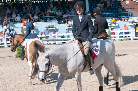 DEVON, PA - MAY 25: Riders performing with their horses at the Devon Horse Show on May 25, 2014 報道画像