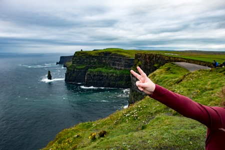 View of Girl at the Cliffs of Moher Tourist Attraction in Ireland