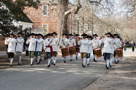Williamsburg, Virgina - March 26, 2018: Reenactment marching band Fife and drum at Colonial WIlliamsburg.