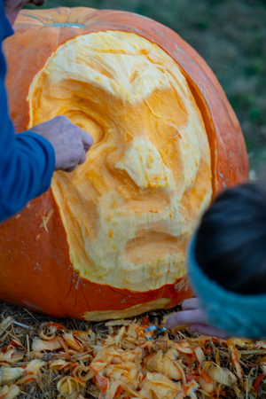 CHADDS FORD, PA - OCTOBER 18: View Person carving pumpkin at The Great Pumpkin Carve carving contest on October 18, 2018 Editöryel