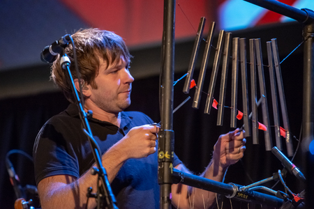 ITHACA, NY - NOVEMBER 4, 2018: Vocalist Andy Ross of the band OK Go performs on their Live Videos tour at the State Theatre of Ithaca