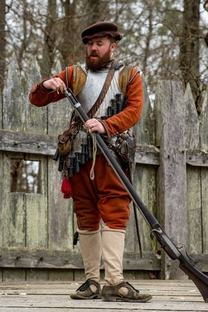 March 27, 2018 - Jamestown, VA: View of a costumed re-enactor demonstrates the firing of a colonial era gun