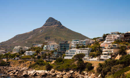 Cape Town, South Africa, February 17 2017: view of Lions Head mountain and apartment buildings with clear blue sky background. This is an iconic view in Cape Town. Sajtókép