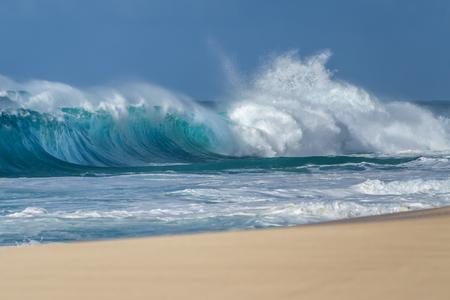 Breaking Ocean wave on the beach in Hawaii