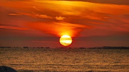 grounded: Grounded Sailboat at Sunset Over St. Josephs Bay in Port St. Joe, FL