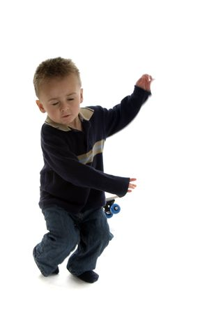 Little boy falling towards the ground with skateboard in background Imagens - 5295123