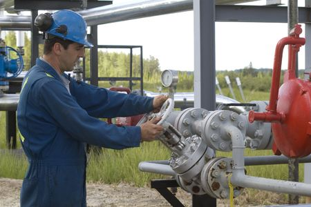 Gas production operator maintains well site Stock Photo - 5295126