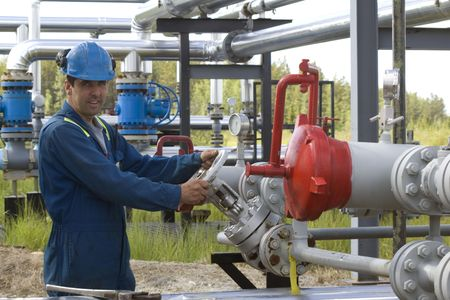 oil tool: Gas production operator maintains well site