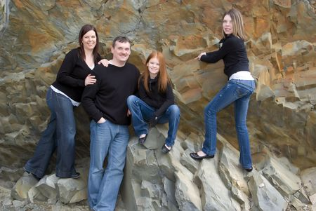 Casual portrait of active family of four taken on cliffs that were once the ocean floor photo