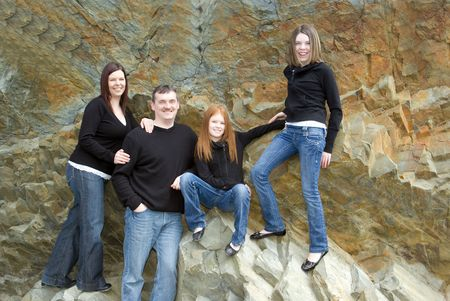 Casual portrait of active family of four taken on cliffs that were once the ocean floor